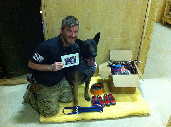 SSGT Miller with K9 Gijis  gifts from FOA and Park Ridge Animal Hospital